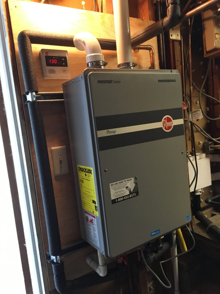 ... and the old storage tank gets upgraded to H/E tankless